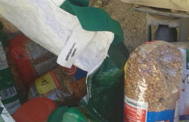 Alimentos de Cáritas en un contenedor de basura de Casar de Cáceres