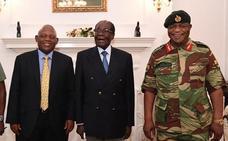 El vicepresidente cesado de Zimbabue regresa y Mugabe se aferra al poder