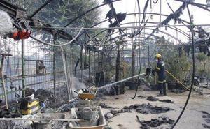 Absueltos por lo penal siete operarios acusados del incendio de la UP en Cáceres