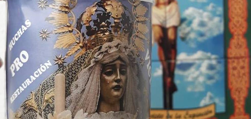 Ya se reparten las huchas para colaborar en la restauración de la Virgen de la Victoria