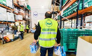 La Caixa y Fesbal recogen 7.300 litros de leche para familias desfavorecidas en Badajoz