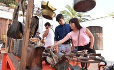 Miles de turistas en el Mercado de las Velas y el Jueves Turístico de Coria