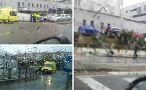 Un coche pierde el control, choca contra un semáforo y vuelca en un aparatoso accidente en Mérida