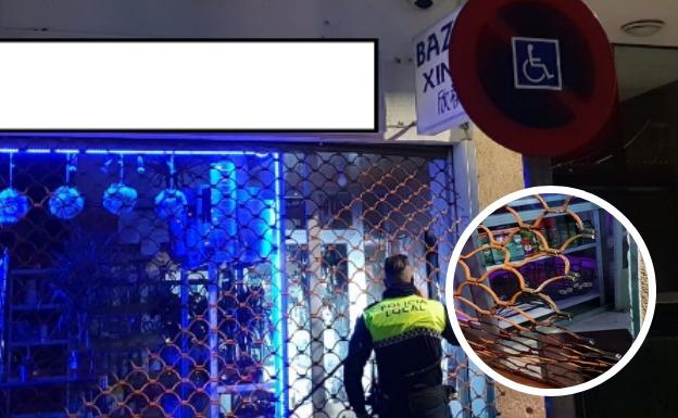 Atrapado por el cierre metálico cuando intentaba robar en un bazar de Badajoz