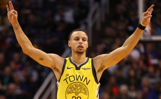 Stephen Curry celebra una canasta /REUTERS