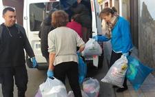Cáritas Parroquial de Malpartida de Cáceres dona 800 kilos de ropa y calzado usado