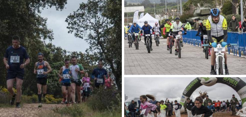 Corredores y ciclistas desafían a la lluvia en Badajoz